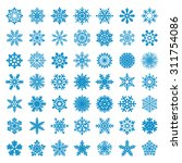 set of vector snowflakes | Shutterstock .eps vector #311754086