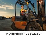 Female Worker Driving Cargo...