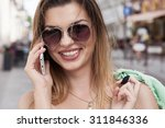 beautiful young brunette woman... | Shutterstock . vector #311846336