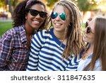 three girls in a city park....   Shutterstock . vector #311847635