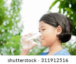 child drinking pure water in... | Shutterstock . vector #311912516