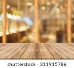 wooden board empty table in... | Shutterstock . vector #311915786