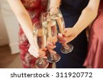 three glasses of champagne... | Shutterstock . vector #311920772