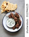 turkish kofta on an enamel... | Shutterstock . vector #311946125