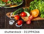 fresh vegetables on a wooden...   Shutterstock . vector #311994266