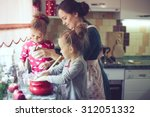 mother with her 5 years old... | Shutterstock . vector #312051332