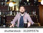 portrait of handsome bartender... | Shutterstock . vector #312095576