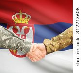 Soldiers shaking hands with flag on background - Serbia