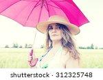 beautiful lady walking on a... | Shutterstock . vector #312325748