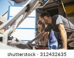 auto mechanic with female... | Shutterstock . vector #312432635