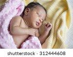 A Sleeping Newborn Baby Girl...