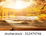 Stock photo wooden top and autumn space and lake 312474746