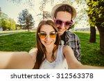 selfie with smartphone  happy... | Shutterstock . vector #312563378