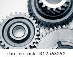 metal cog gears joining... | Shutterstock . vector #312568292