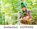 woman with basket full of... | Shutterstock . vector #312593306