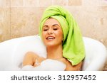 spa laughing woman relaxing in... | Shutterstock . vector #312957452