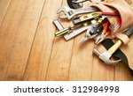 tool belt with tools on wood... | Shutterstock . vector #312984998