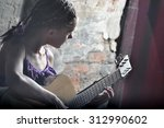 young teenage girl playing... | Shutterstock . vector #312990602