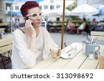 red haired woman sitting... | Shutterstock . vector #313098692