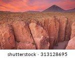 a narrow canyon with a volcano...   Shutterstock . vector #313128695