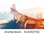 woman relaxing in mountains | Shutterstock . vector #313202702