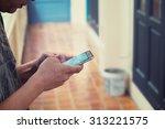 old man holding smartphone...   Shutterstock . vector #313221575