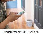 old man holding smartphone...   Shutterstock . vector #313221578