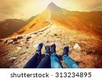 tourism in mountains. a couple... | Shutterstock . vector #313234895