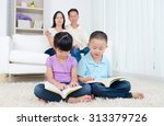 asian family reading book at... | Shutterstock . vector #313379726