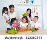 asian family in the kitchen | Shutterstock . vector #313382996
