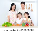 asian family in the kitchen | Shutterstock . vector #313383002
