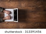 male hands working on a white... | Shutterstock . vector #313391456