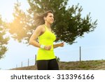 woman running in countryside at ... | Shutterstock . vector #313396166