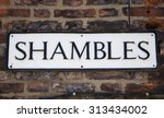 a street sign for the shambles...
