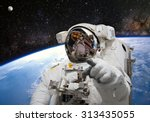 astronaut on space mission.... | Shutterstock . vector #313435055