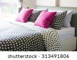 empty modern bed in bedroom | Shutterstock . vector #313491806