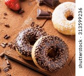 Chocolate And Sugar Donuts Wit...