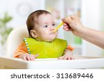 kid girl eating healthy food... | Shutterstock . vector #313689446