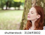 close up thoughtful pretty... | Shutterstock . vector #313693832