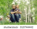 dad walks with her daughter in... | Shutterstock . vector #313744442