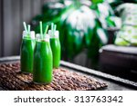 fresh green smoothie outdoors | Shutterstock . vector #313763342