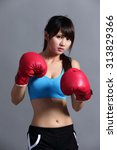 woman is boxing  asian beauty | Shutterstock . vector #313829366