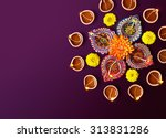 colorful clay diya lamps with... | Shutterstock . vector #313831286