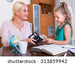 Small photo of Allowance of pocket money: little girl and smiling mother with purse