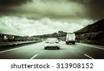 rear view of a car driving an... | Shutterstock . vector #313908152