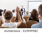 photo of listener raising hand... | Shutterstock . vector #313949582