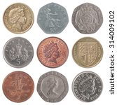 A Set Of British Coins On Whit...