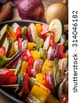 vegetable skewers on a cast... | Shutterstock . vector #314046182