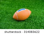 toy football on artificial... | Shutterstock . vector #314083622