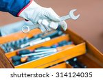 mechanic's hand holding a wrench | Shutterstock . vector #314124035